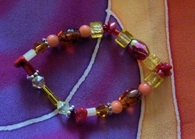 Scarf Accessory for a silk scarf in yellow, orange, red and brown tones