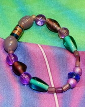 Scarf Accessory for a silk scarf in green, violet and gold tones